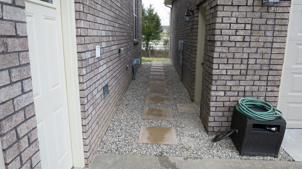 Lovely Between House And Detached Garage Was Tight So We Did A Gravel And Paver  Tile Solution To Avoid Water Issues.